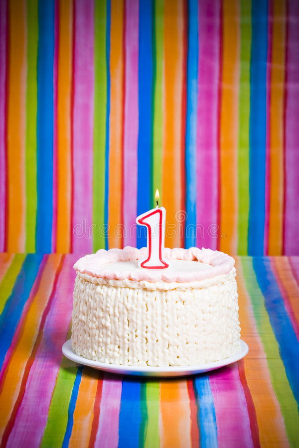 First celebration cake. A cake with a candle royalty free stock images