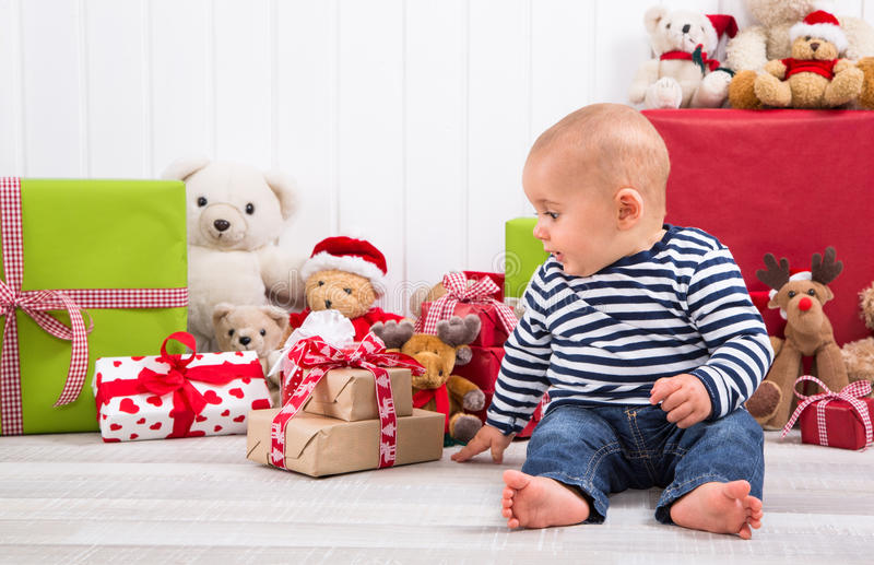 Download First Christmas: Baby Unwrapping A Present Stock Photo - Image of celebration, infant: 35128910