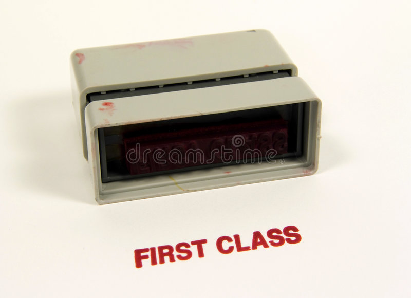 First Class. Photo of a First Class Stamp stock images