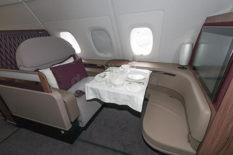 First class Qatar. PARIS - JUN 18, 2015: First class seat ina Qatar Airways Airbus A380. The A380 is the largest passenger airliner in the world royalty free stock images