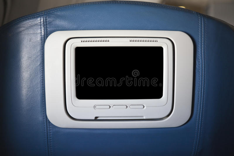 First Class Seat Back. First class set back on a common jet aircraft stock image