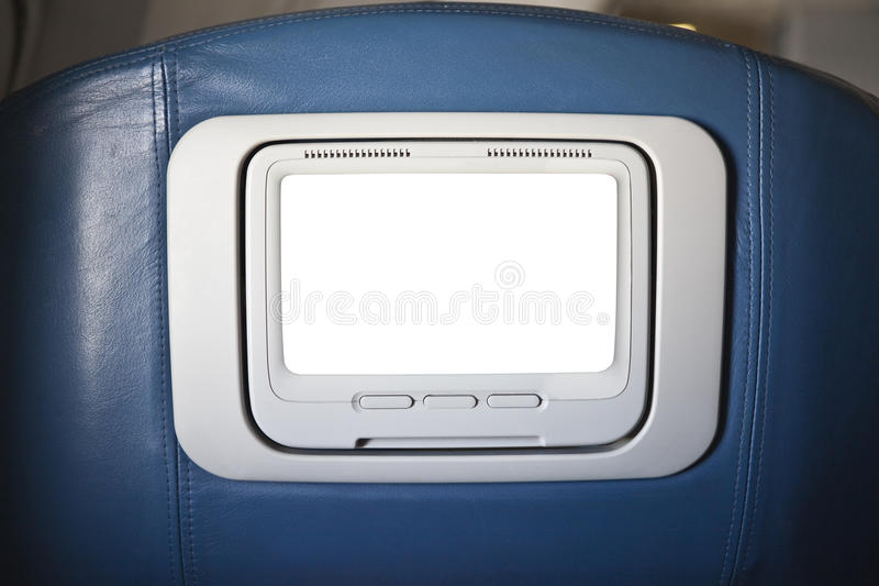 First Class Seat Back Cut Out TV Screen. First class seat back television set with cut out screen royalty free stock photos