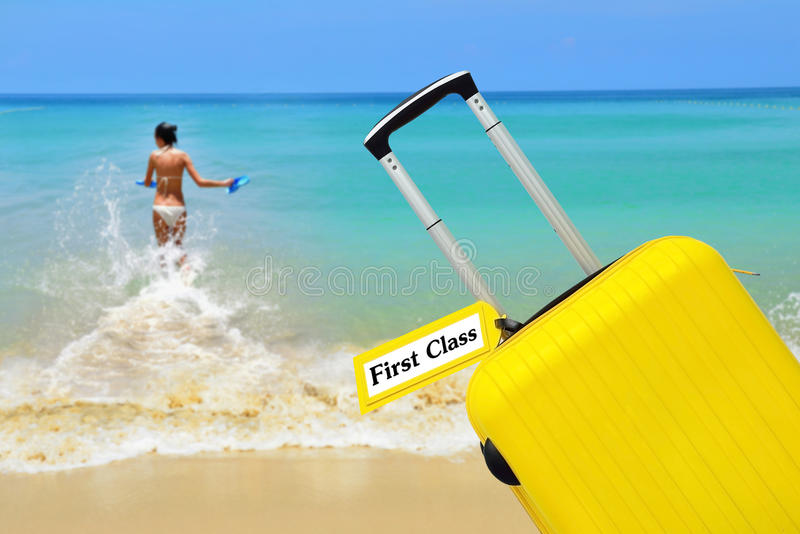 First Class. suitcase with label. First Class, suitcase with label stock photos