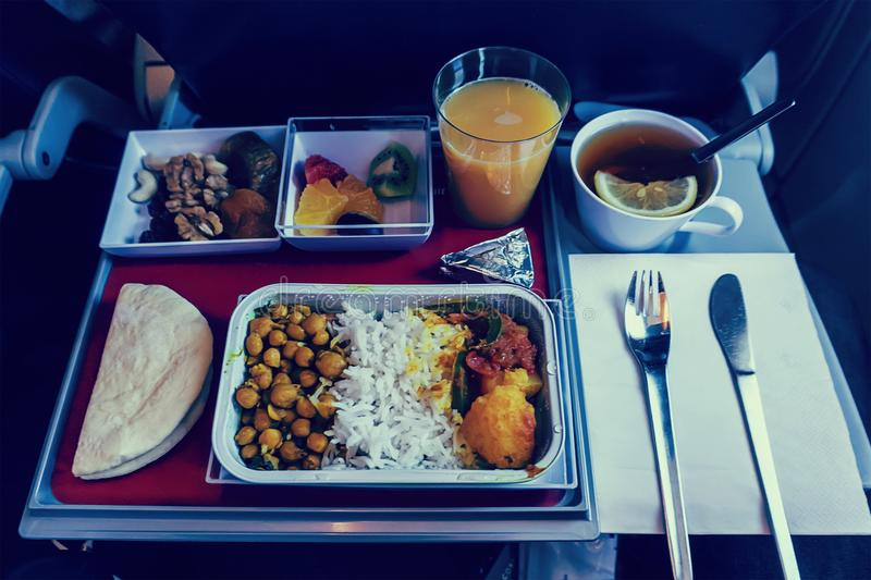 First Class Travel. A large set of meals provided by the airline for long-distance passengers during the flight stock photo