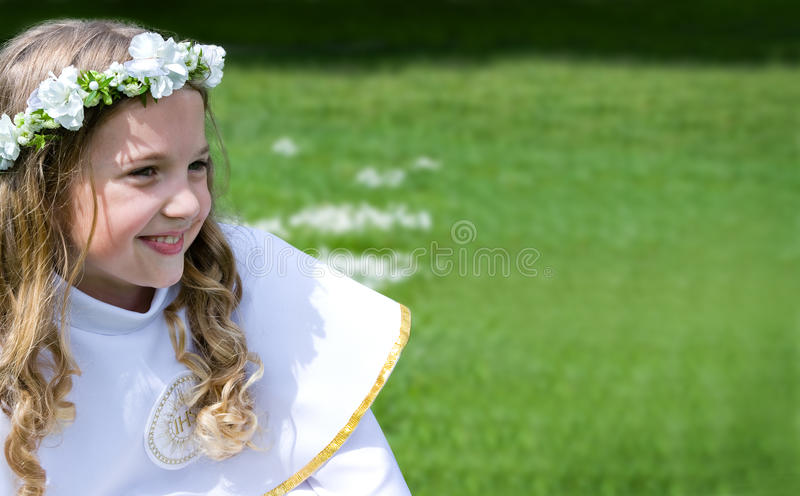 First Communion beautiful girl stock photography