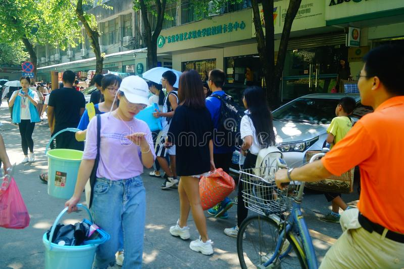 Guangzhou, China: on the first day of college, many freshmen arrive at the university campus. On the first day of college in guangzhou, many freshmen come to the stock images
