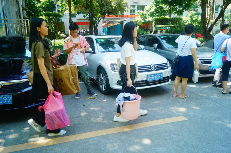Guangzhou, China: on the first day of college, many freshmen arrive at the university campus. On the first day of college in guangzhou, many freshmen come to the stock photography