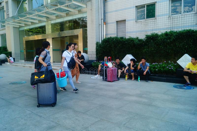 Guangzhou, China: on the first day of college, many freshmen arrive at the university campus. On the first day of college in guangzhou, many freshmen come to the stock photo
