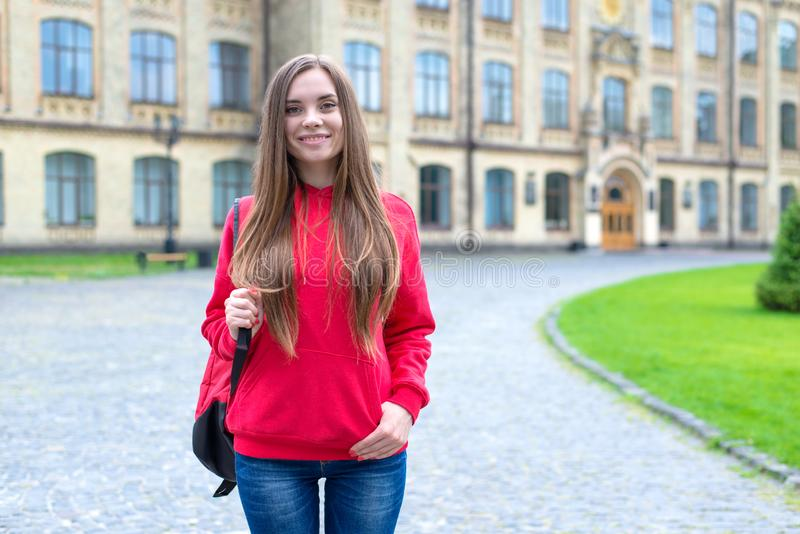 First day at new private institute concept. Photo of optimistic charming lovely clever intelligent girl standing in front of. Building royalty free stock photos