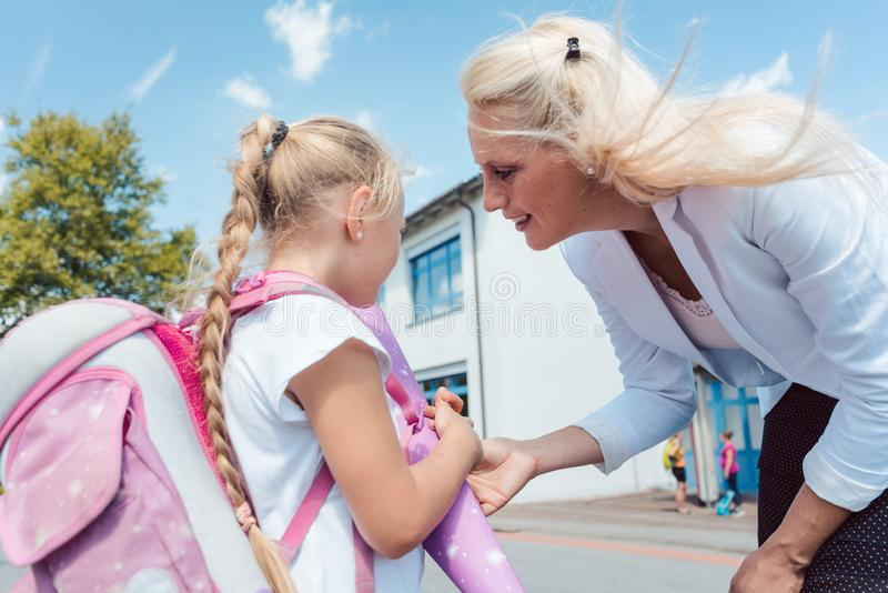 First day in school for little girl royalty free stock photo