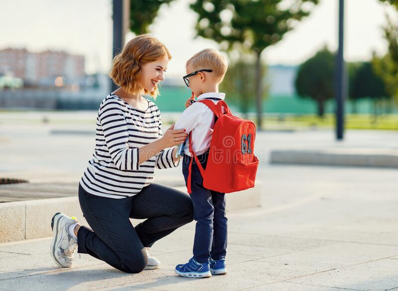 First day at school. mother leads  little child boy in grade stock images