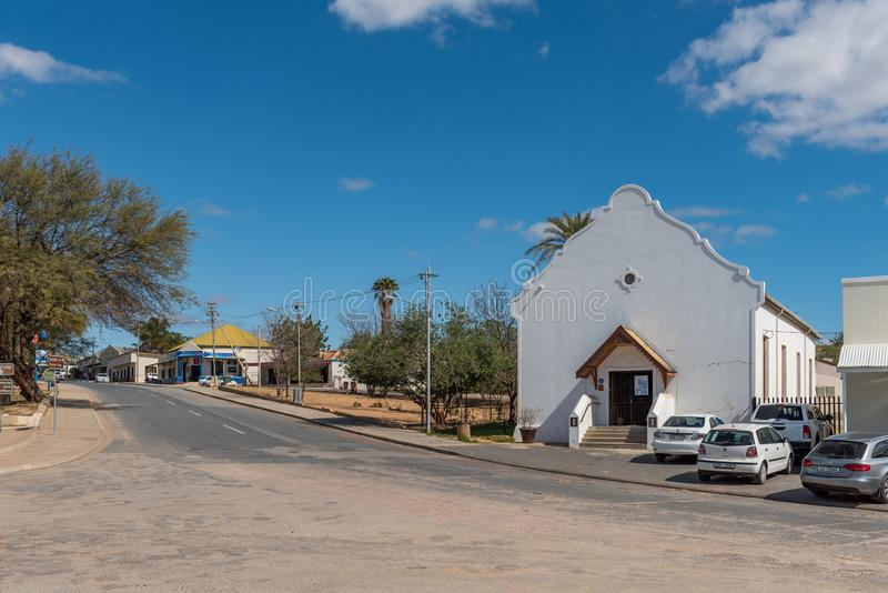 First Dutch Reformed Church Hall, now information centre, in Clanwilliam. CLANWILLIAM, SOUTH AFRICA, AUGUST 22, 2018: A street scene, with the historic first royalty free stock photography