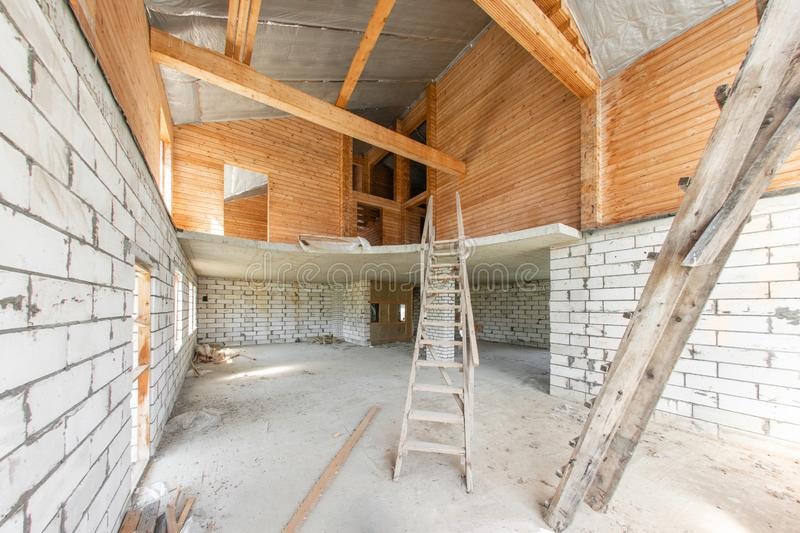 Combined house of wooden beam logs and bricks. The first floor of the house. overhaul and reconstruction. House or. The first floor of the house. overhaul and stock photo