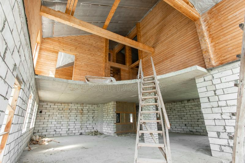 Combined house of wooden beam logs and bricks. The first floor of the house. overhaul and reconstruction. House or. The first floor of the house. overhaul and royalty free stock image