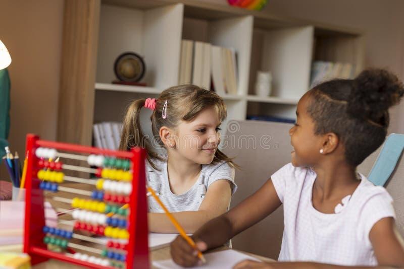 First grade girls practising math royalty free stock photos