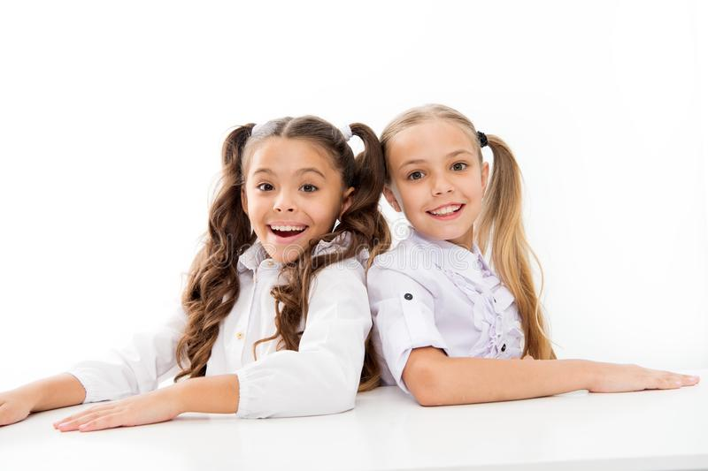 First grade. Happy childhood. Adorable schoolgirls. Back to school. Education concept. Beautiful girls best friends stock photos