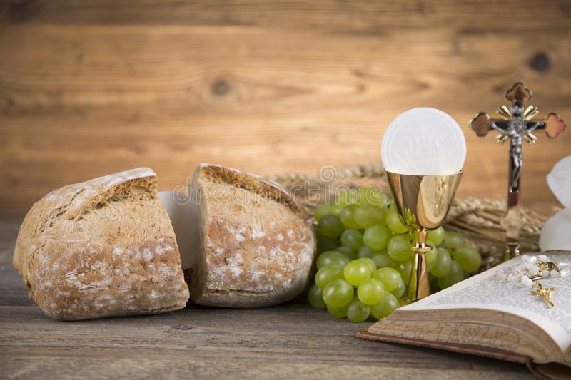 Eucharist symbol of bread and wine, chalice and host, First comm stock photography
