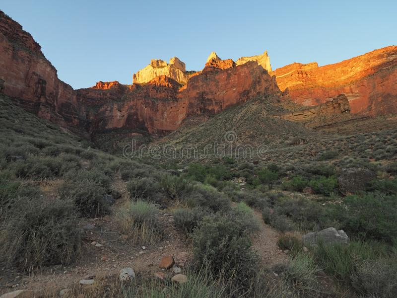 Grand Canyon National Park, Arizona. First light on canyon walls along the Tonto Trail in Grand Canyon National Park, Arizona royalty free stock photography
