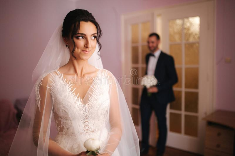 First look of groom and bride at home. Emotions stock photography