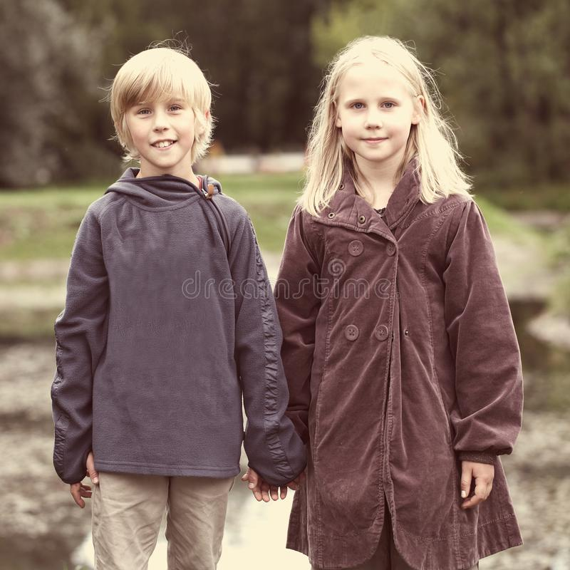 First love, romantic concept, little boy and girl holding hands royalty free stock photos