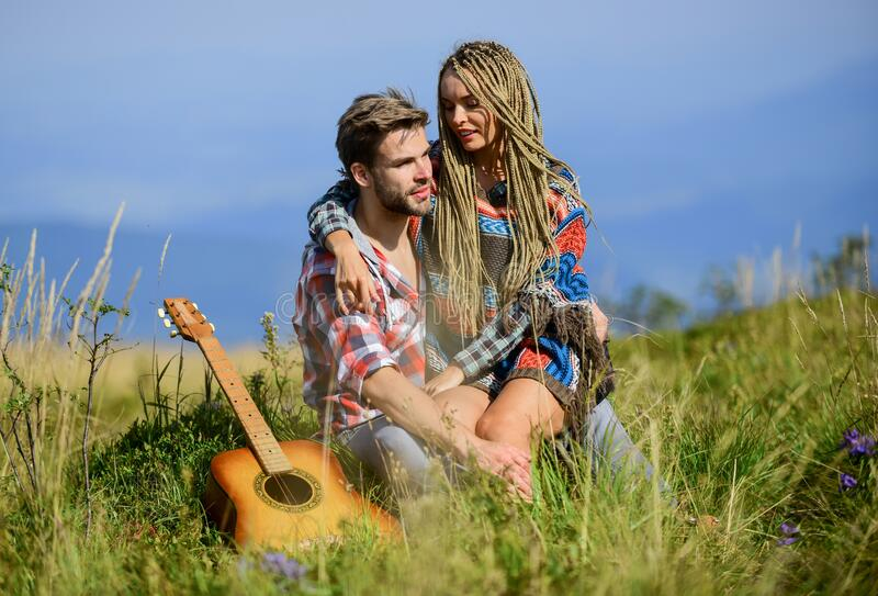 First meet. happy friends with guitar. western camping. hiking. friendship. campfire songs. men play guitar for girl stock photos