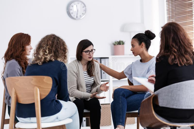 First meeting of Women`s issues support group meeting, group therapy concept royalty free stock photo