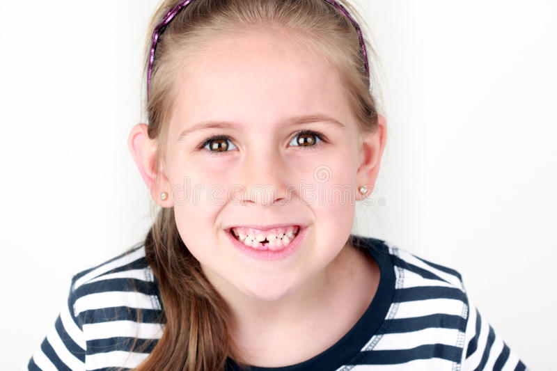 First missing tooth. Happy girl with her first missing tooth royalty free stock images