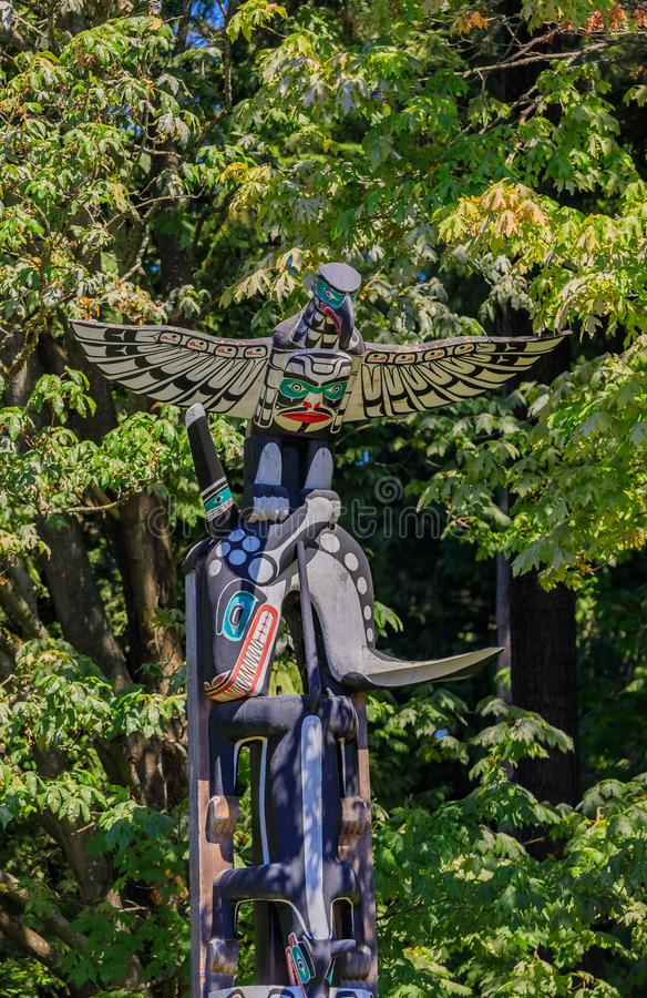 First Nations American Indian totem poles in Stanley Park in Van stock images