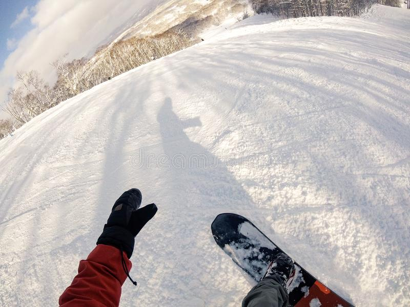 First person perspective of a snowboarder looking down the mountain stock photos