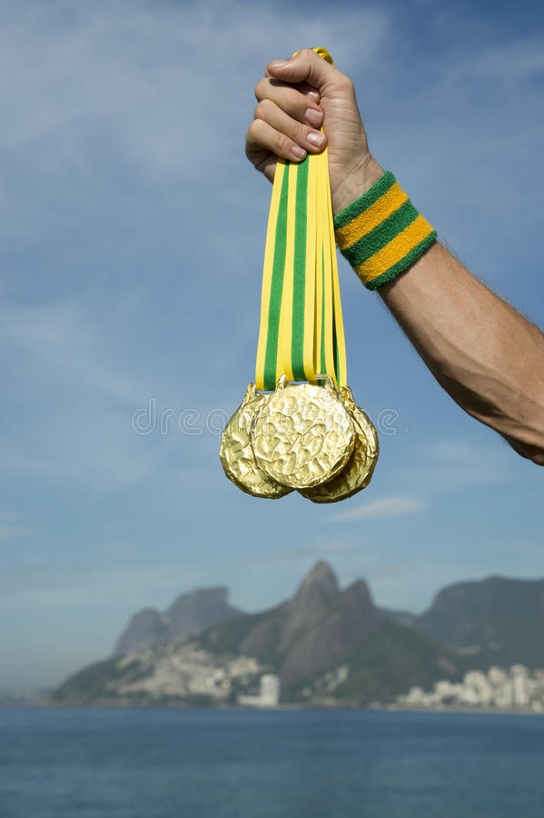 First Place Athlete Holding Medals Ipanema Beach Rio. First place athlete holding gold medals standing outdoors on Ipanema Beach Rio de Janeiro Brazil royalty free stock images