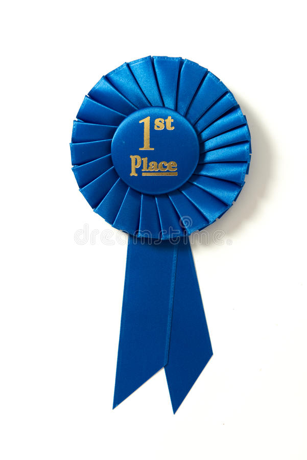 First place blue ribbon on white royalty free stock image