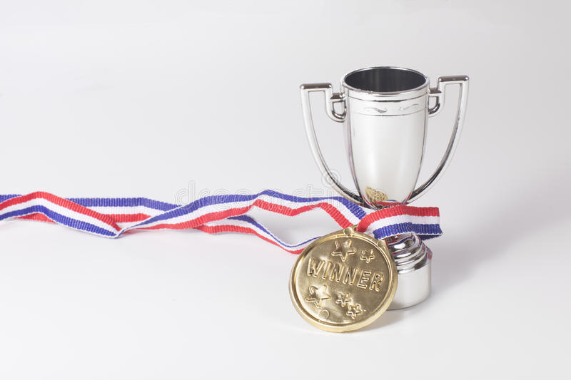 First place gold medal and winners trophy royalty free stock photos