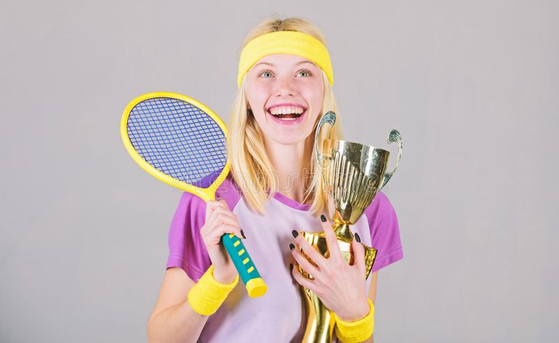 First place. Sport achievement. Celebrate victory. Tennis champion. Athletic girl hold tennis racket and golden goblet. Win tennis game. Tennis player win royalty free stock photos