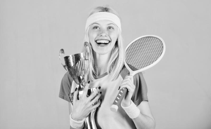 First place. Sport achievement. Celebrate victory. Tennis champion. Athletic girl hold tennis racket and golden goblet. Win tennis game. Tennis player win royalty free stock image