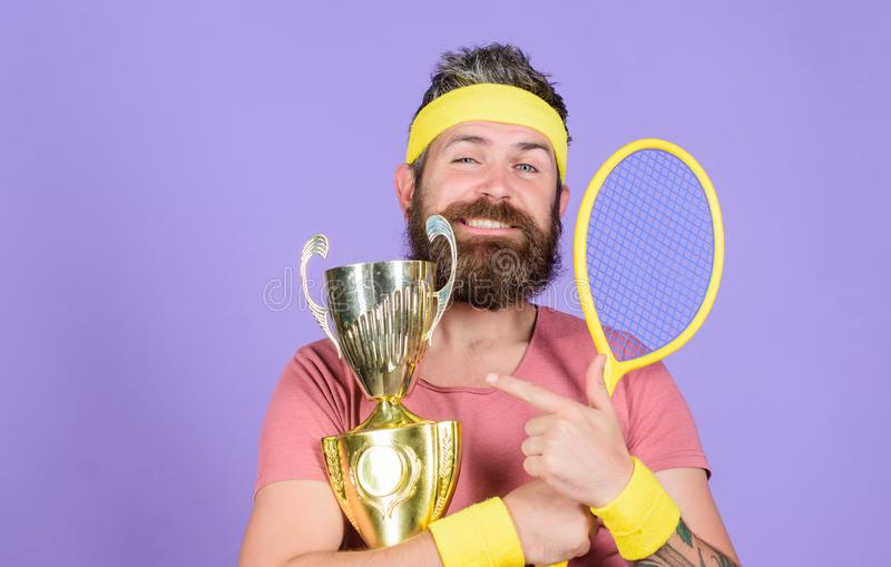 First place. Sport achievement. Tennis champion. Win tennis game. Celebrate victory. Athletic man hold tennis racket and stock photos