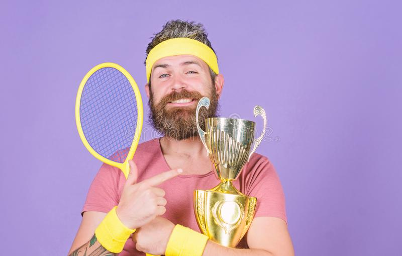 First place. Sport achievement. Tennis champion. Win tennis game. Celebrate victory. Athletic man hold tennis racket and. Golden goblet. Tennis player win royalty free stock photos
