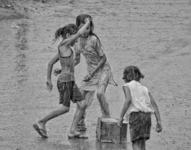 The First Rain. When rain drops hits the ground, the pain, stress and exhaustion comes to an end and it`s only happiness all around. Children came out of their royalty free stock photos