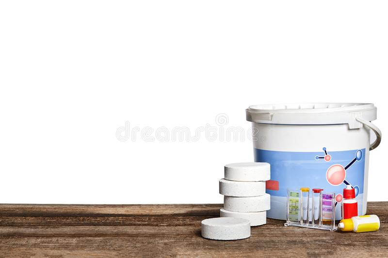 Equipment with chemical cleaning products and tools for the maintenance of the swimming pool on a wooden surface against. First-rate chemical cleaning products stock photos
