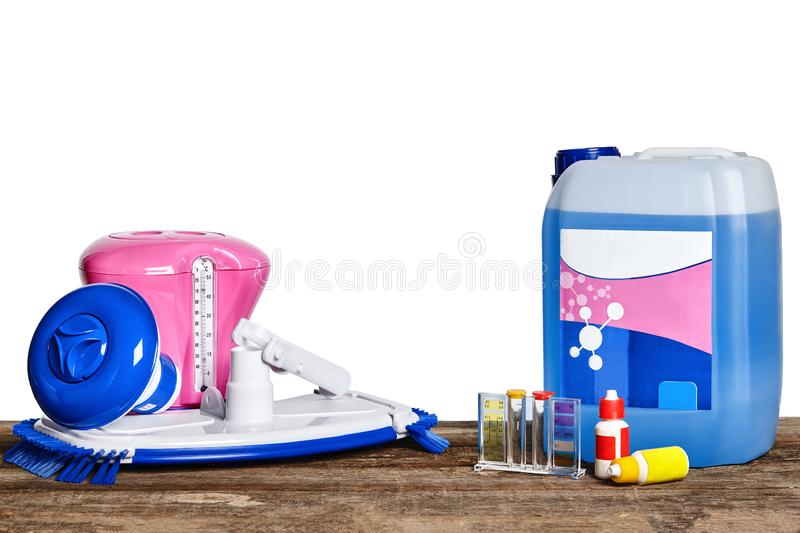 Equipment with chemical cleaning products and tools for the maintenance of the swimming pool on a wooden surface against. First-rate equipment with chemical stock photography