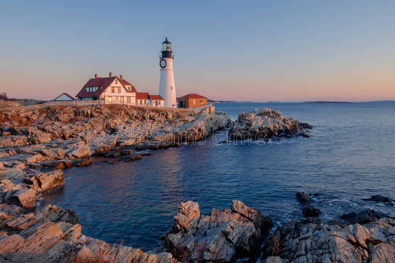The first rays of sunrise hits the Maine Coast turning the Rocks royalty free stock image
