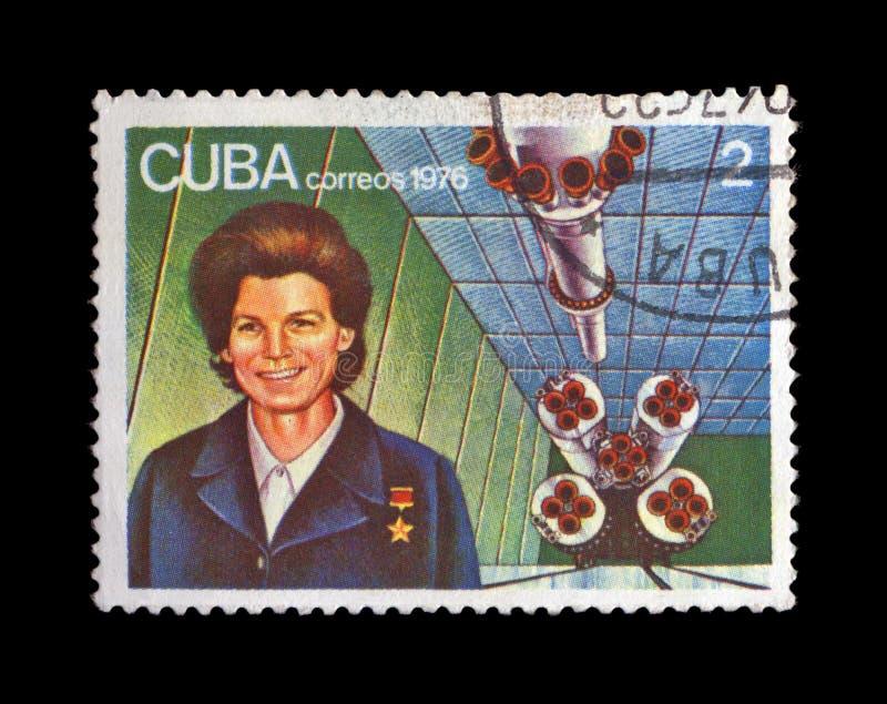 First russian, soviet astronaut Valentina Tereshkova, rocket shuttle,. CUBA - CIRCA 1976: canceled stamp printed in CUBA, shows first russian, soviet astronaut stock photos