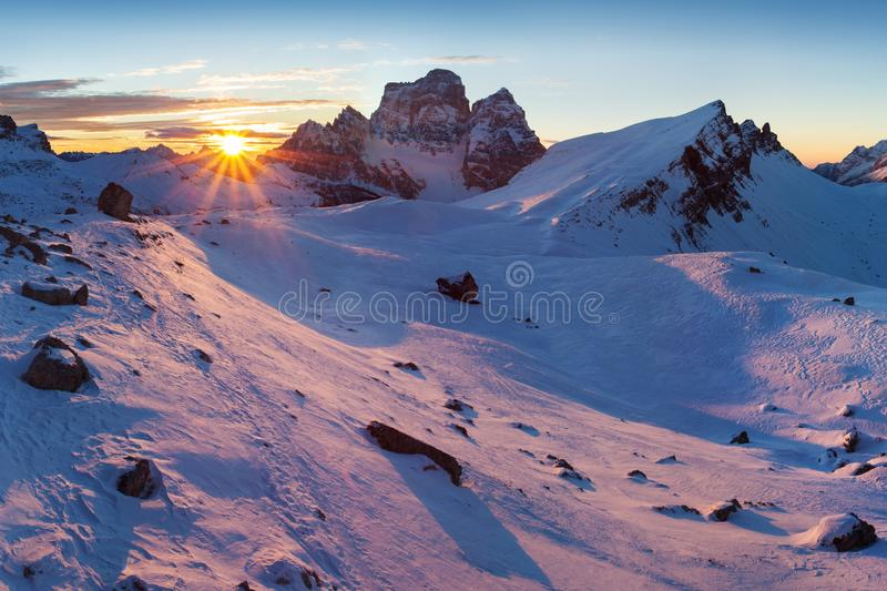 First snow in Alps. Fantastic sunrise in the Dolomites mountains, South Tyrol, Italy in winter. Italian alpine panorama Dolomites. royalty free stock image