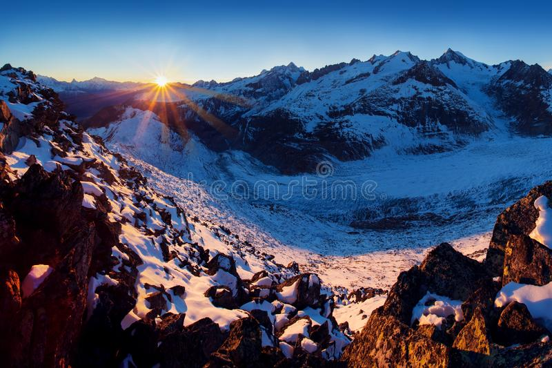 First snow in Alps mountains. Majestic panoramic view of Aletsch glacier, the largest glacier in Alps at UNESCO heritage. stock photos