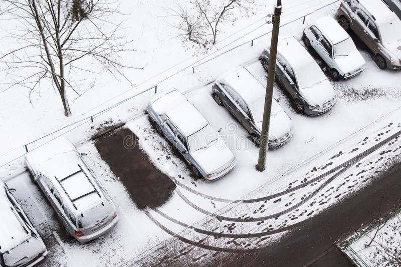 First snow. Cars under snow on a parking stock photo