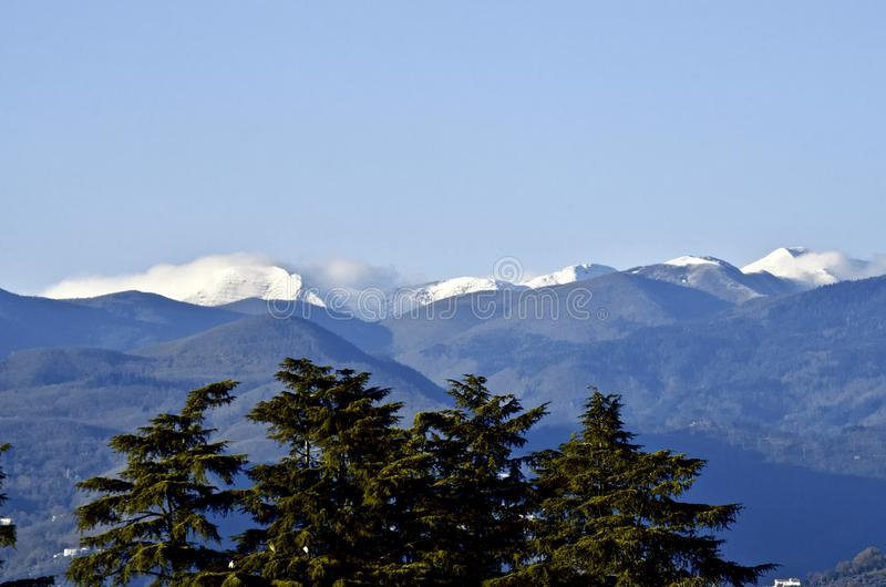 First snow on Montagna Pistoiese ridge seen from Pistoia stock images