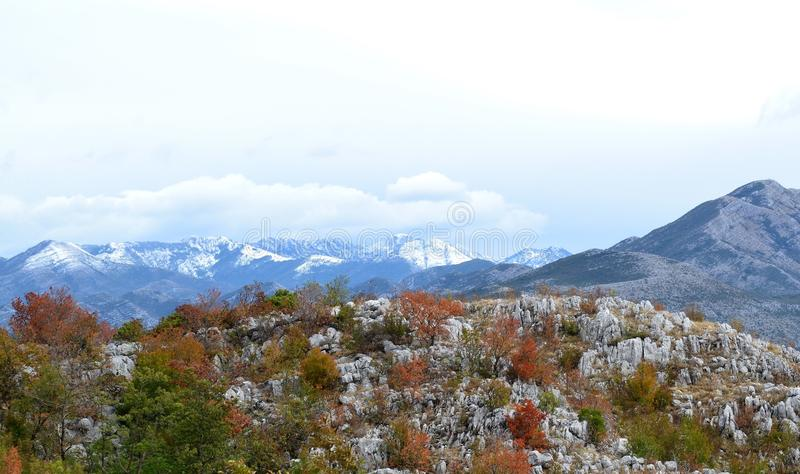 First snow in Montenegro`s mountains. View from Dalmatia Mountains to Montenegro stock photos