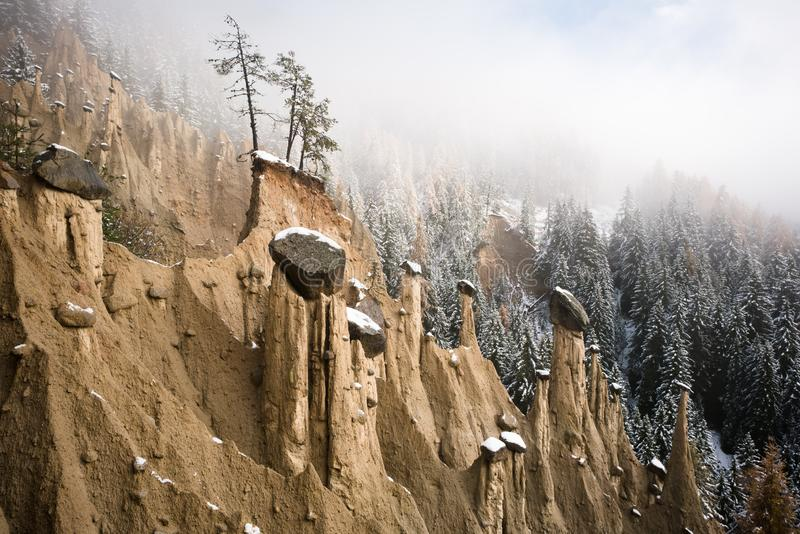 First snow over Perca Earth Pyramids stock photography