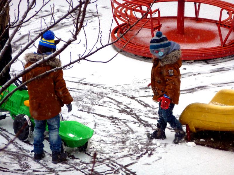 First snow at the playground in yellow, green and red stock images
