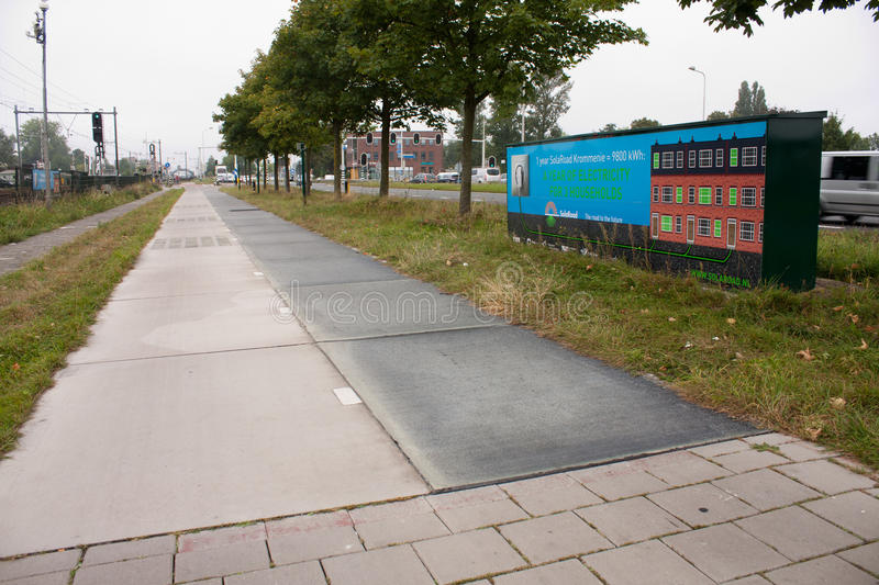 First solar cycle lane in the world. KROMMENIE - SEPTEMBER 17: First solar cycle lane in the world, created by SolaRoad company. Generates electric energy to stock image