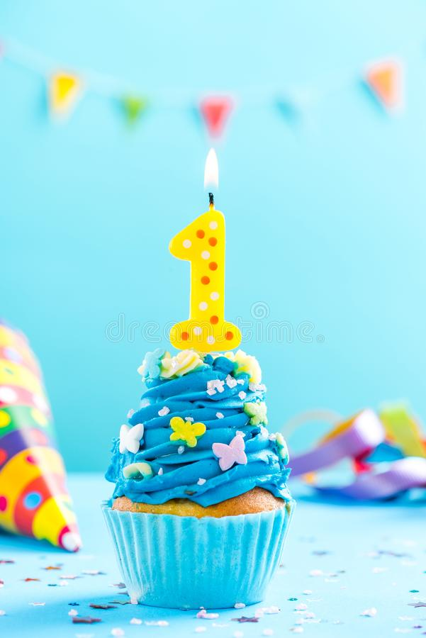 First 1st birthday cupcake with candle and sprinkles. Card mockup. stock photos